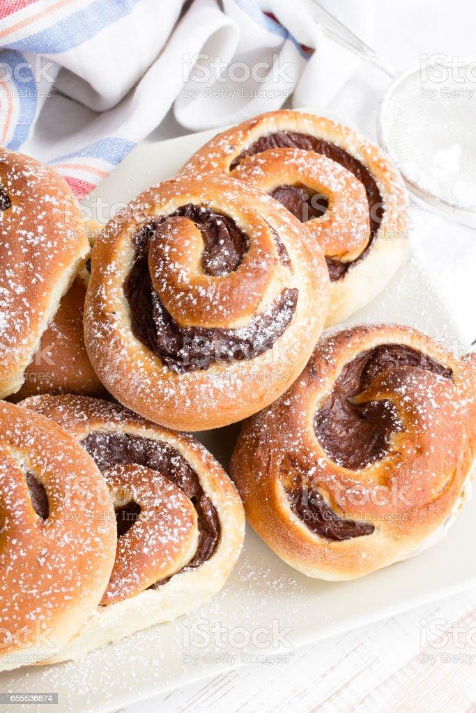 Homemade sweet buns with chocolate cream stock photo