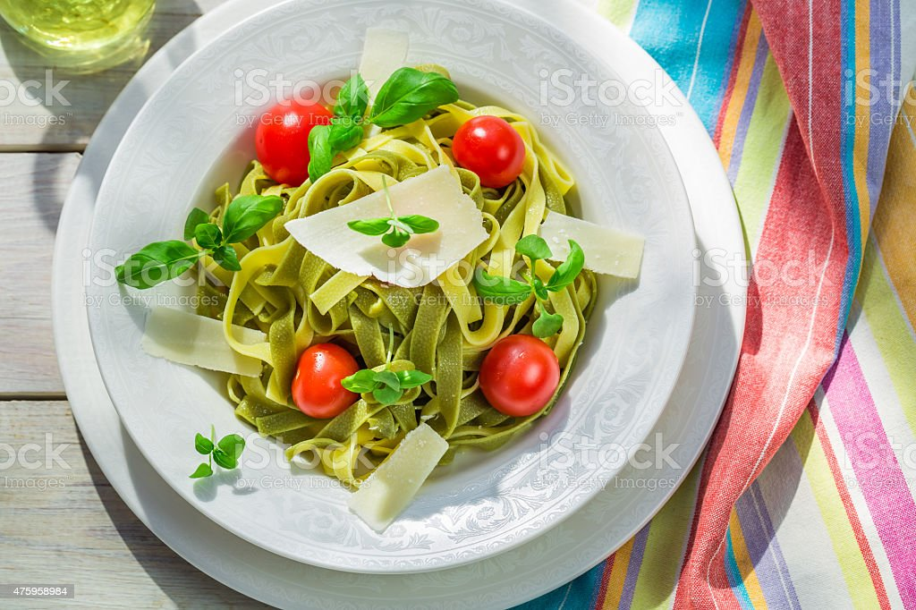 Homemade tagliatelle with basil and tomato stock photo