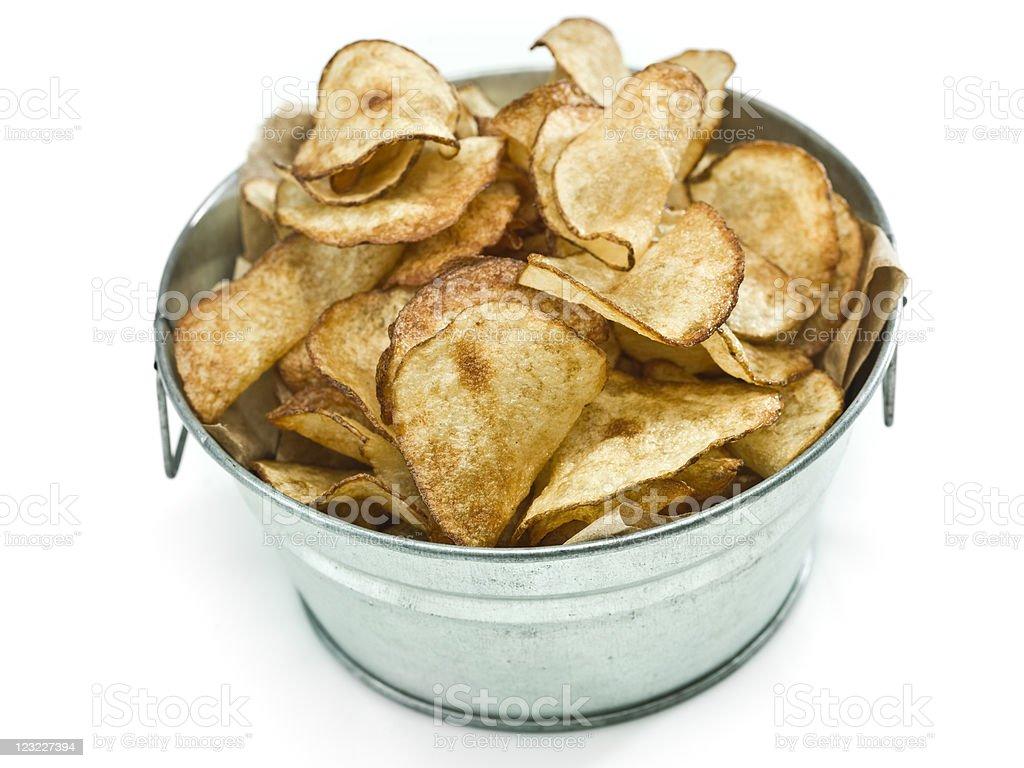 Homemade thin potato chips in a bucket royalty-free stock photo