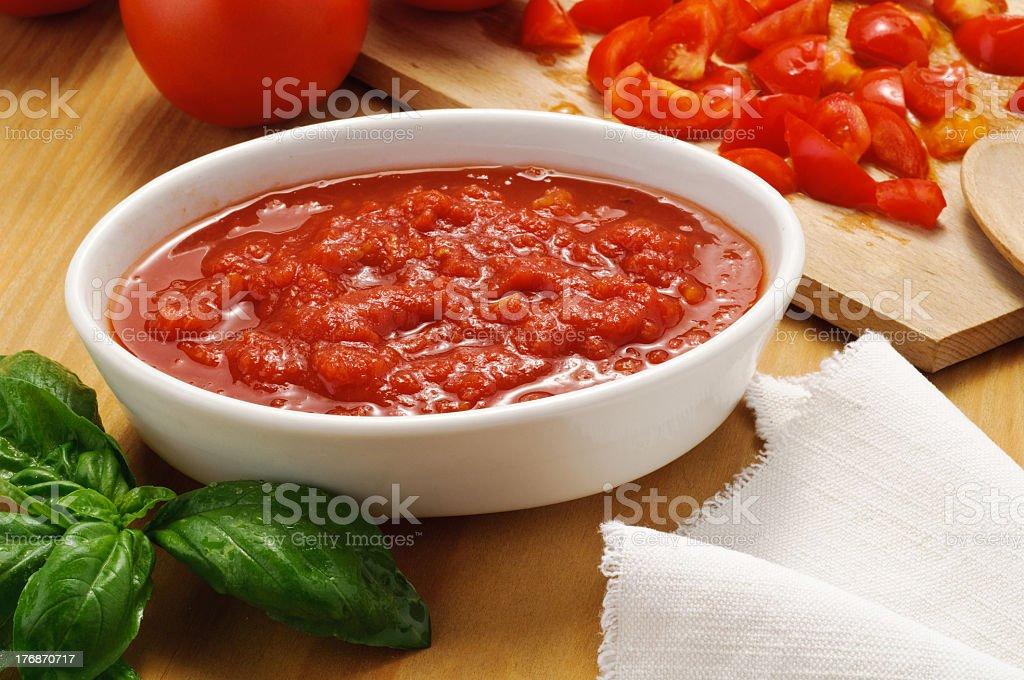 Homemade tomato sauce in a white bowl stock photo