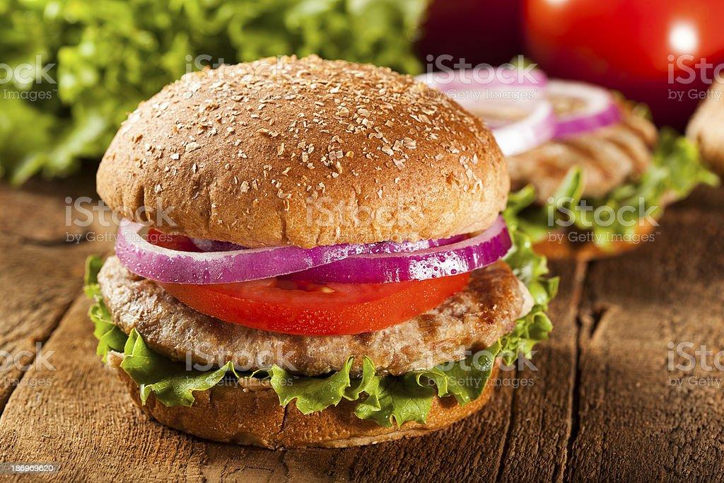 Homemade turkey burger on a bun with salad stock photo