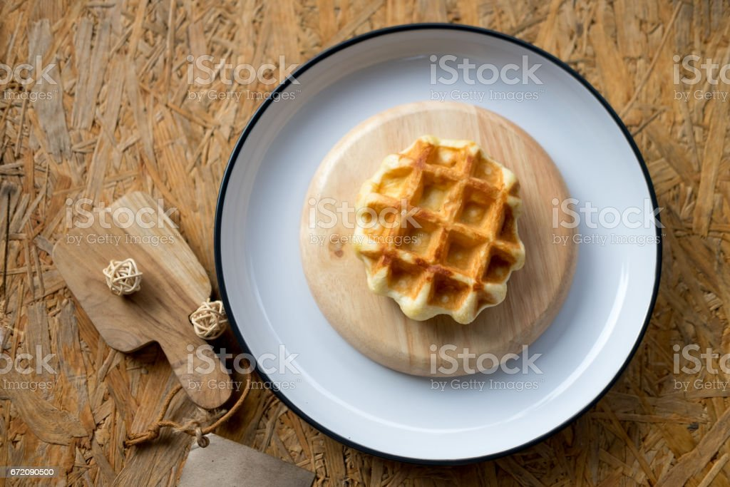 Homemade waffle on white dish, top view stock photo