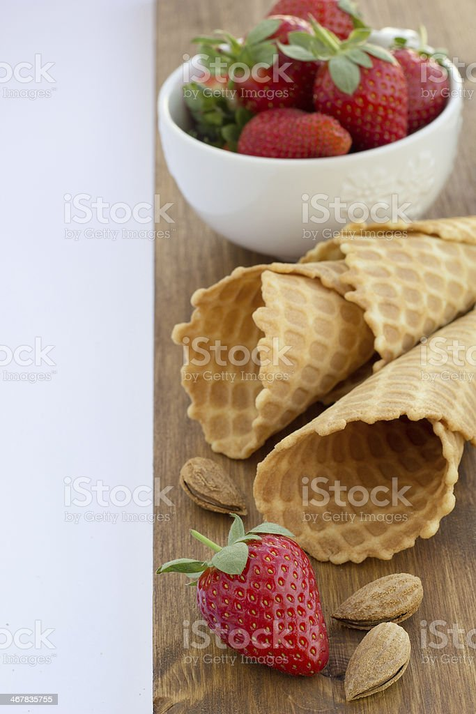Homemade waffle with strawberry on a wooden surface royalty-free stock photo