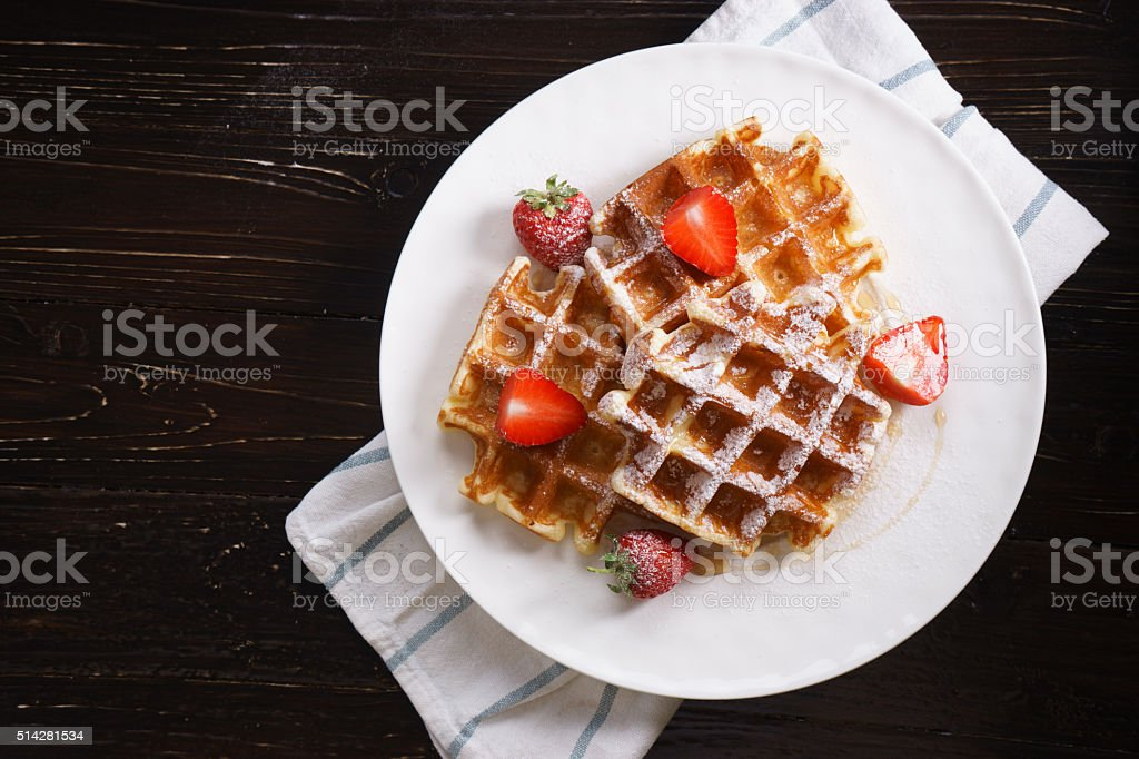 Homemade waffles with syrup and strawberry stock photo