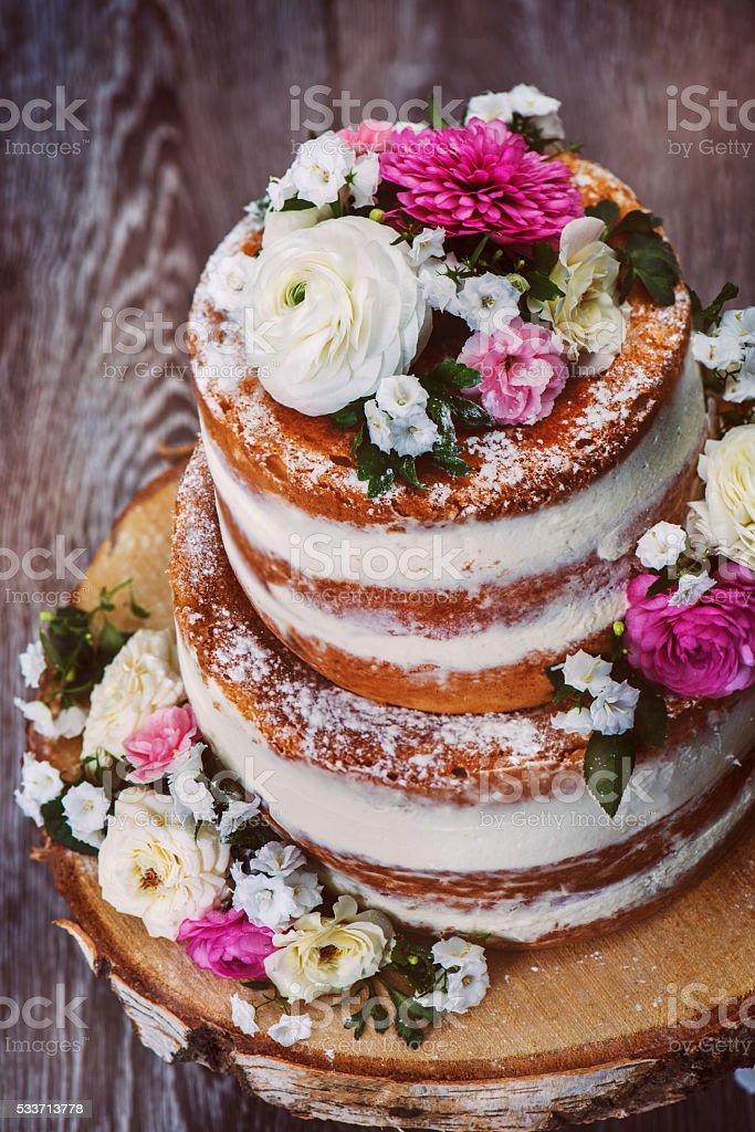 Homemade wedding naked cake stock photo