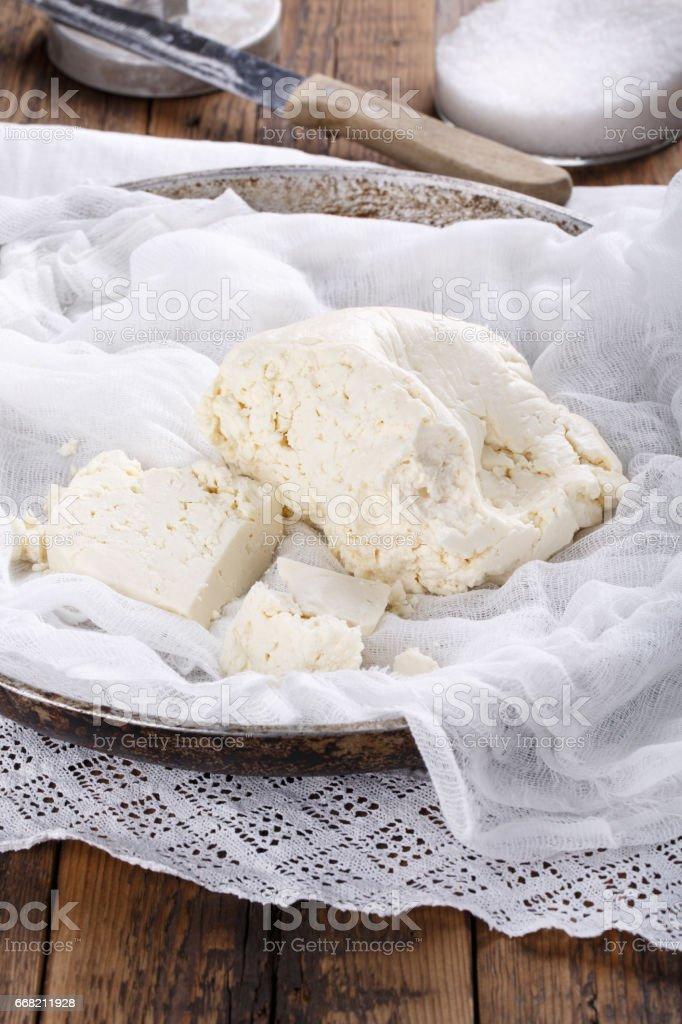 Homemade white brined feta cheese. Dairy products.  Raw organic brynza. stock photo