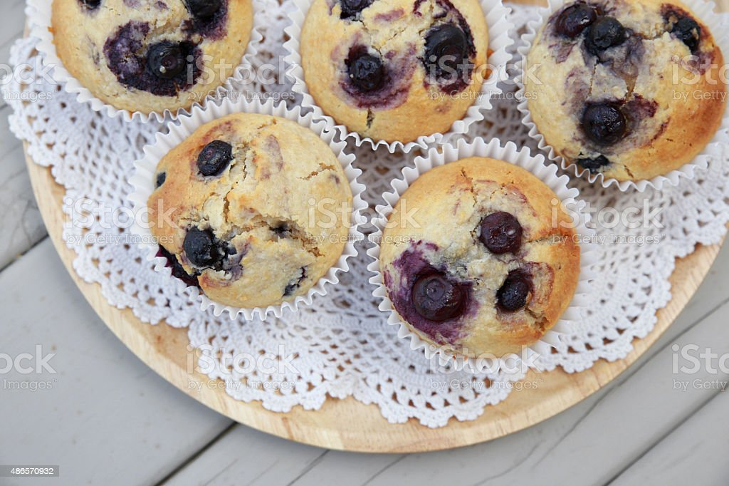 Homemade wholemeal coconut blueberry muffins stock photo
