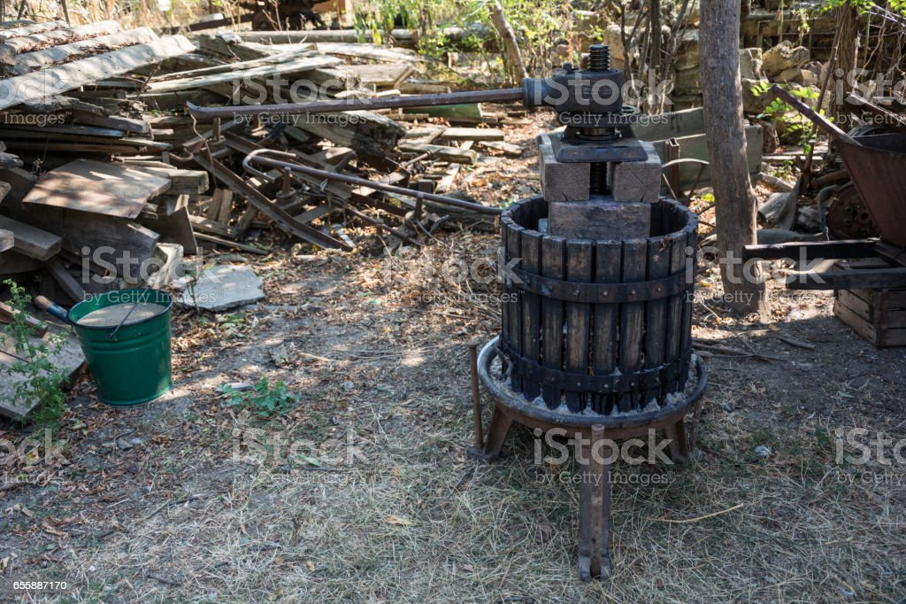 Homemade wine press in the household of the village of Ukraine stock photo