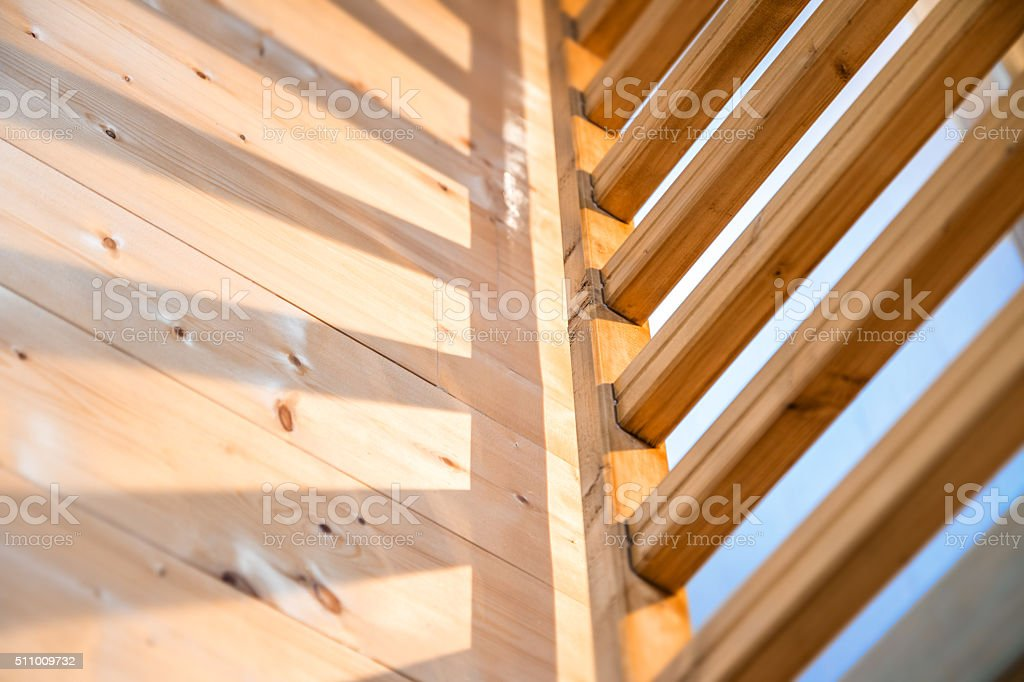 Homemade wooden railing and its shadow on parquet floor stock photo