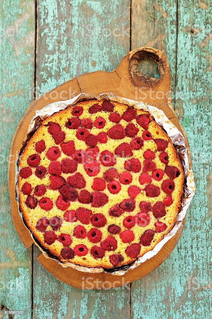 Homemade yummy cake with raspberries baked in foil stock photo