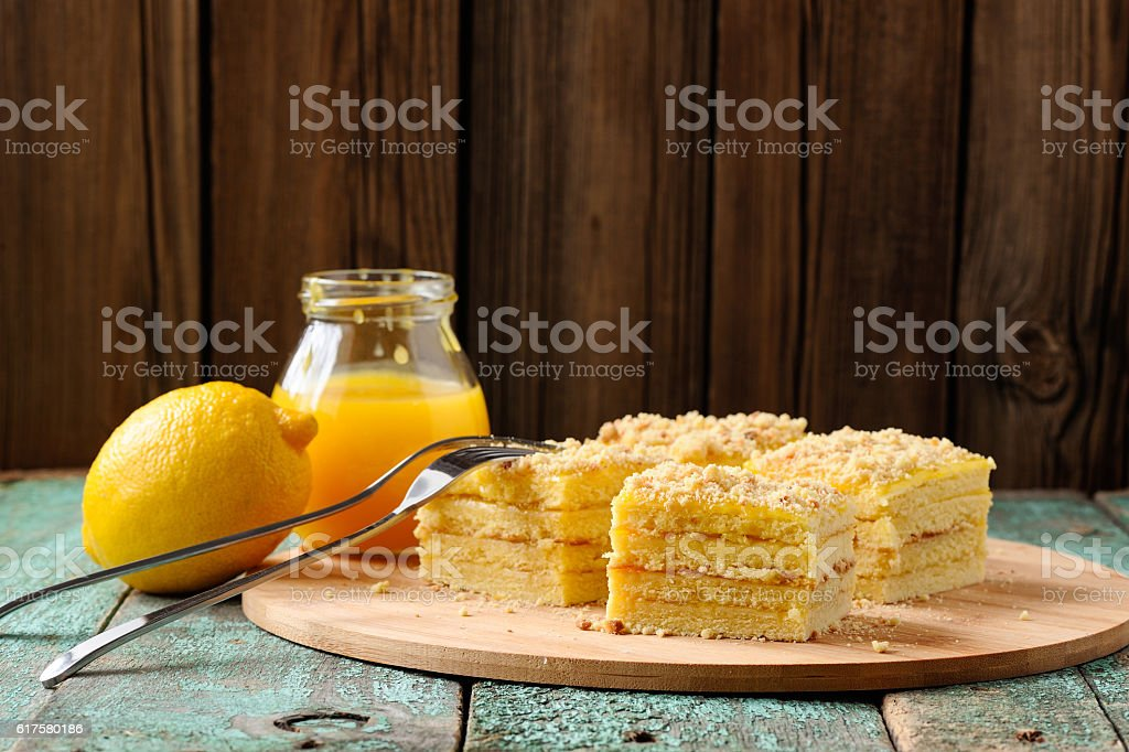 Homemade yummy lemon cake with lemon curd stock photo