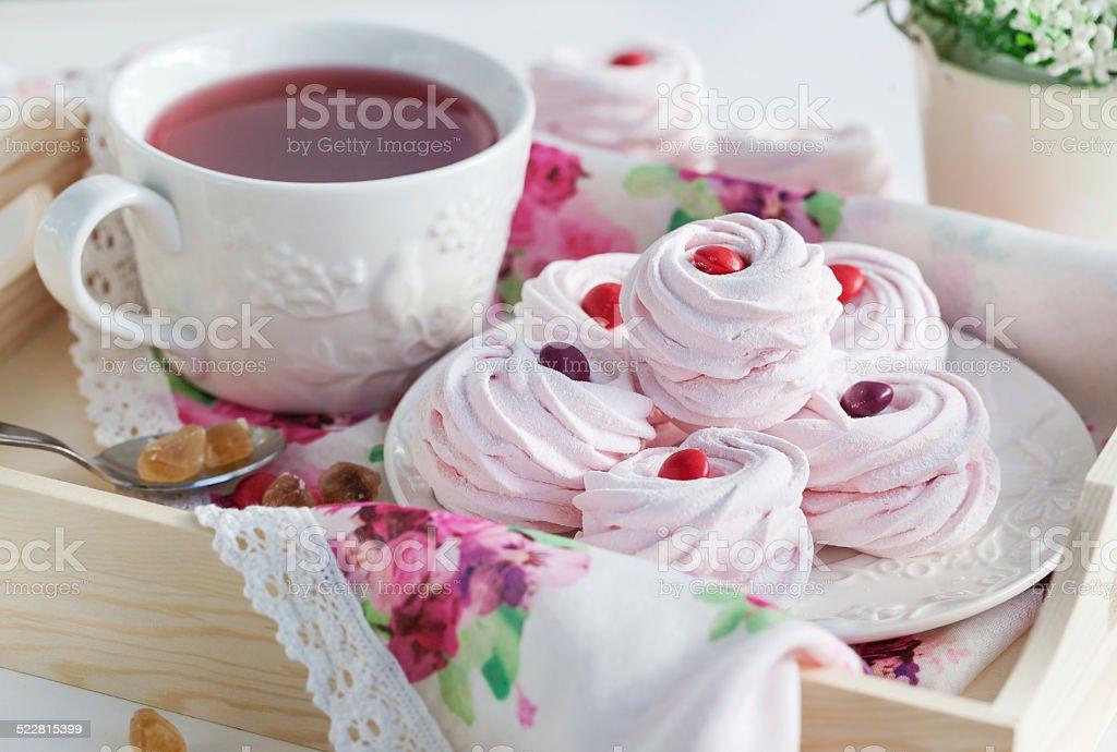 Homemade zefir (marshmallows) and cup of tea stock photo