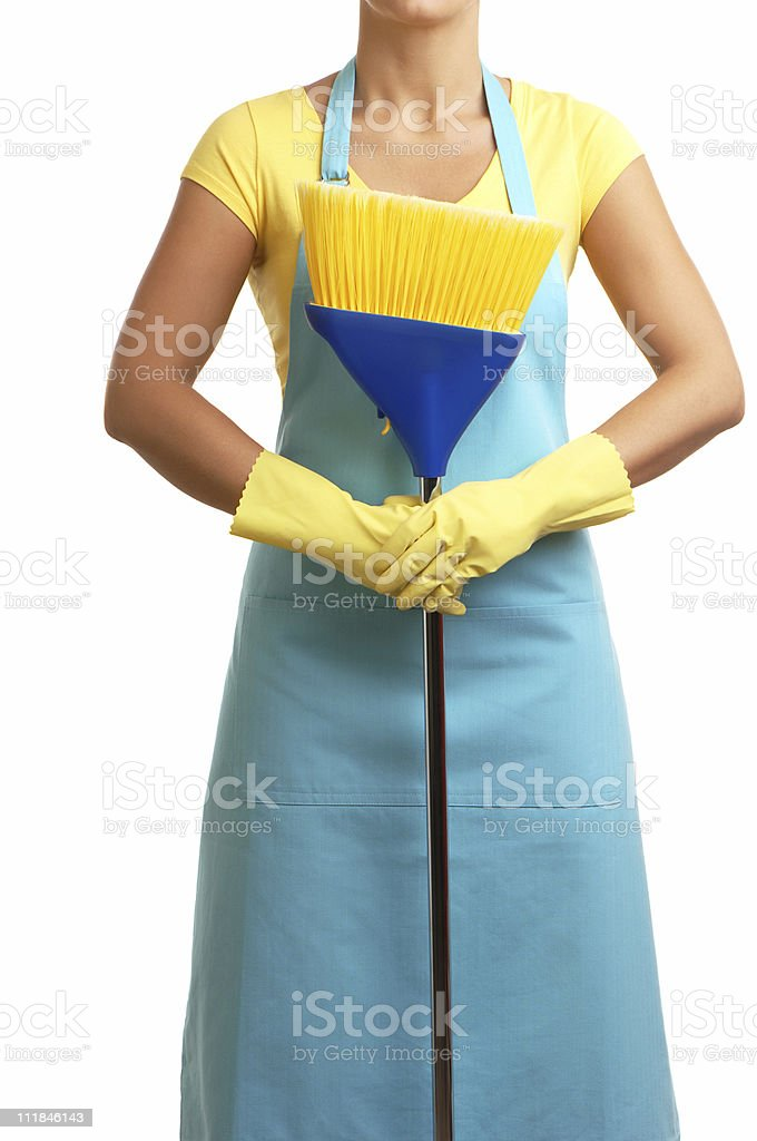 Homemaker in Apron with Broom and Rubber Gloves on White stock photo