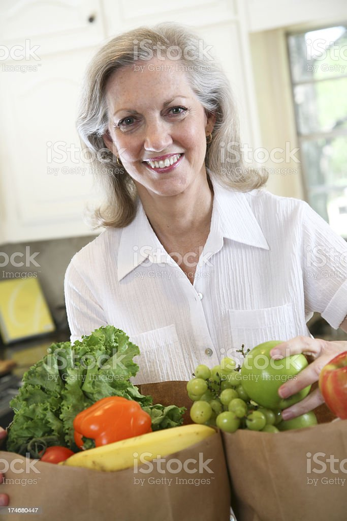 Homemaker Smiling With Her Bags of Groceries royalty-free stock photo