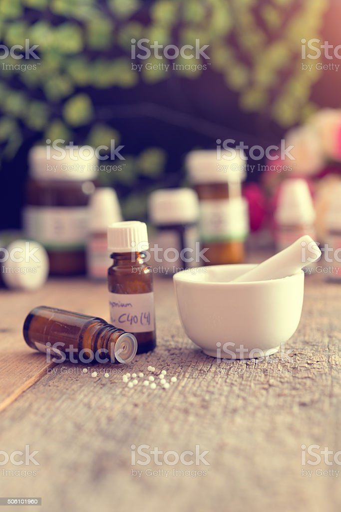 homeopathic medicine - globuli and mortar stock photo