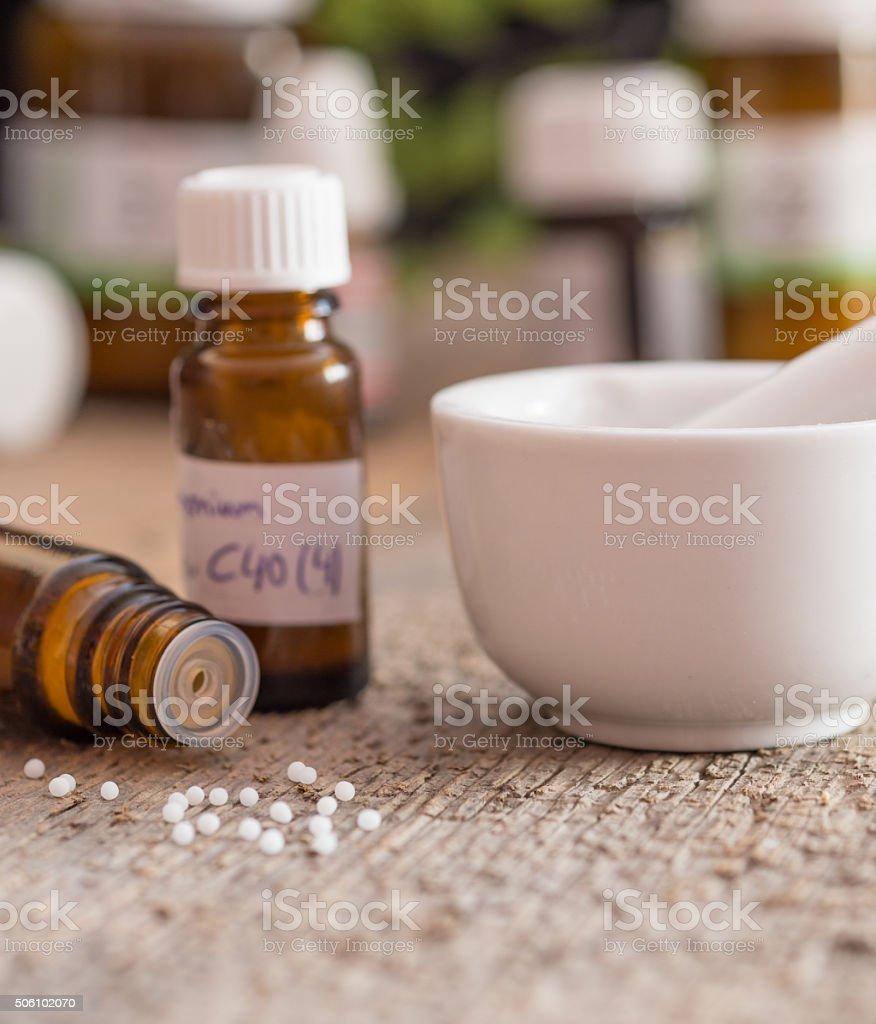 homeopathic medicine - globuli and mortar stock photo