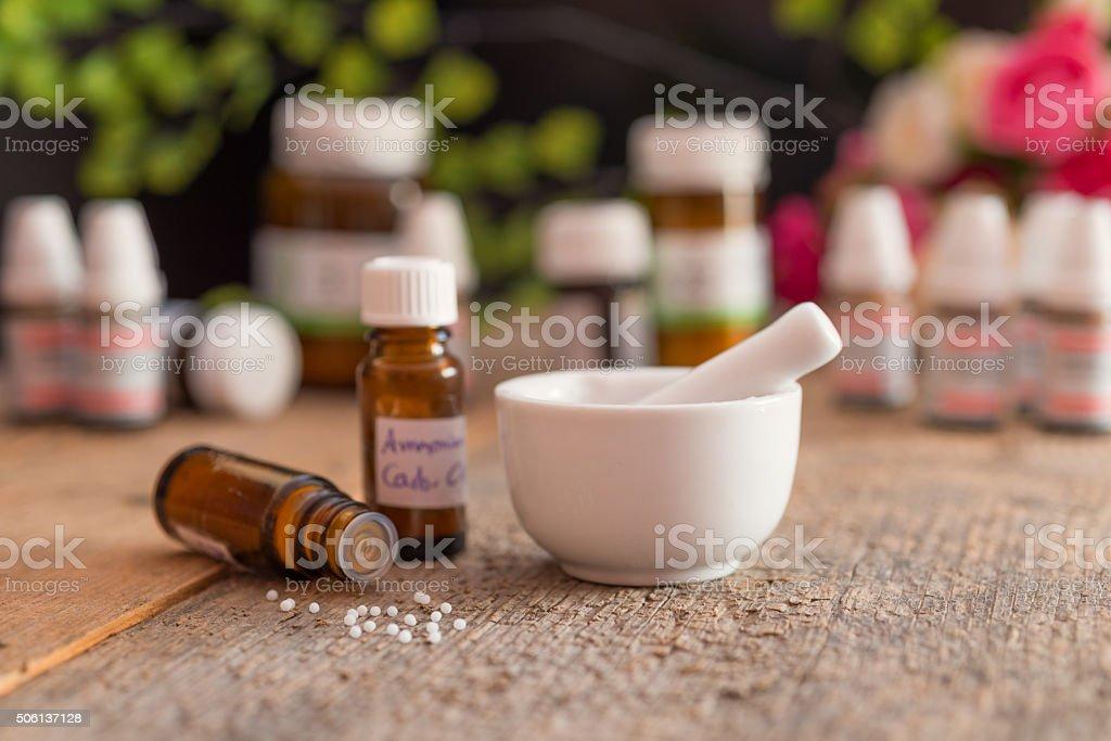 homeopathic medicine - globuli on table stock photo