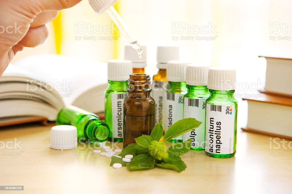 Homeopathic Medicine: Remedies and Books stock photo