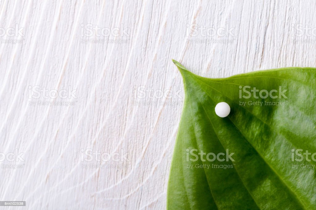 Homeopathy - A homeopathy concept with homeopathic medicine background stock photo