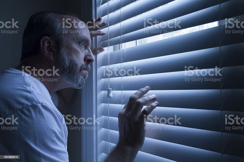 Homeowner Nervously Checks On Outside Noise Late At Night royalty-free stock photo