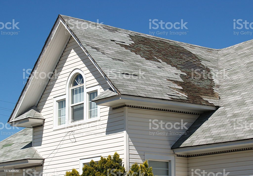 Homeowner Roof Repair stock photo