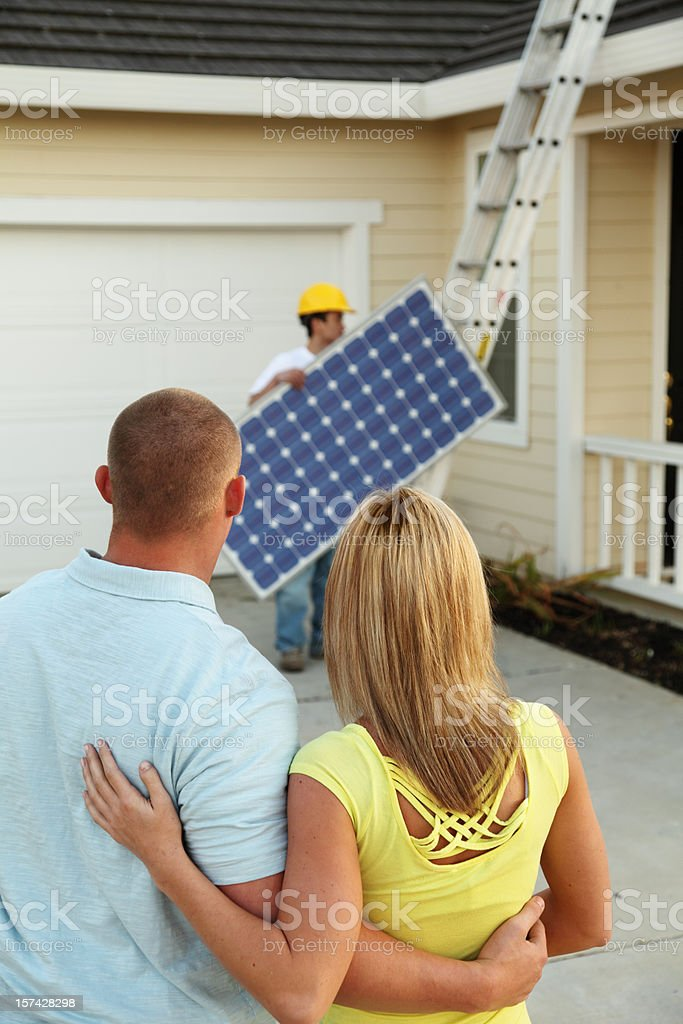 Homeowners Getting A Solar Electric System royalty-free stock photo
