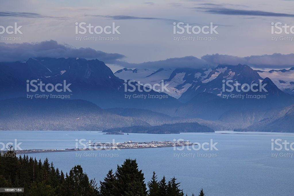 Homer Spit in Kachemack Bay surrounded by glacier filled mountains stock photo