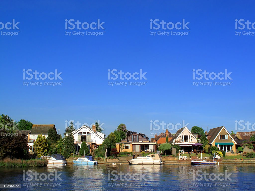 Homes And Moored Boats On The River Thames stock photo