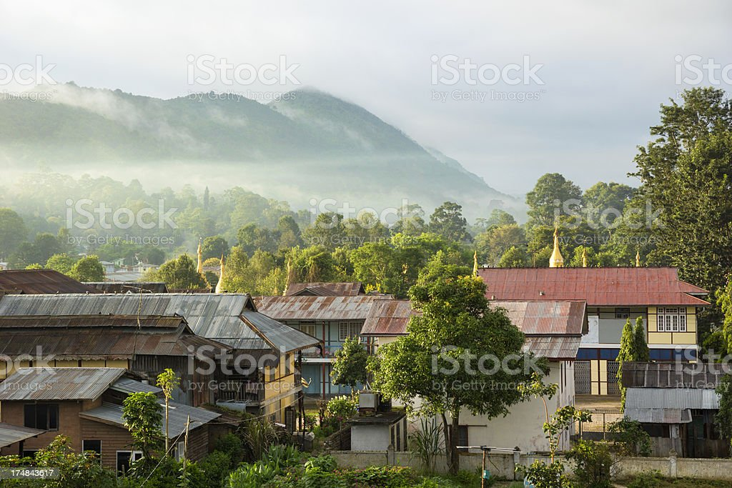 Homes and pagodas at sunset in Kalaw (Myanmar) stock photo