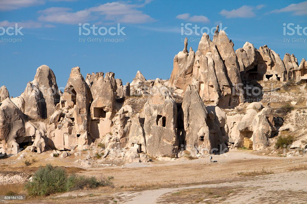 Homes carved into rugged tufa in Goreme valley, Turkey stock photo