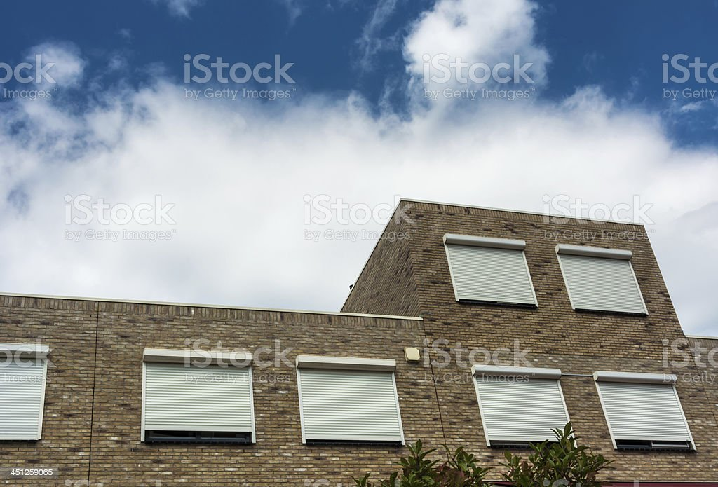 homes closed shutters stock photo