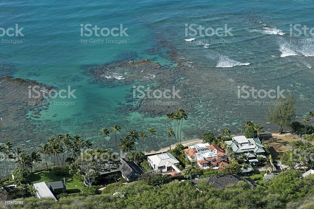 Homes on ocean shore at base of crater in Oahu royalty-free stock photo