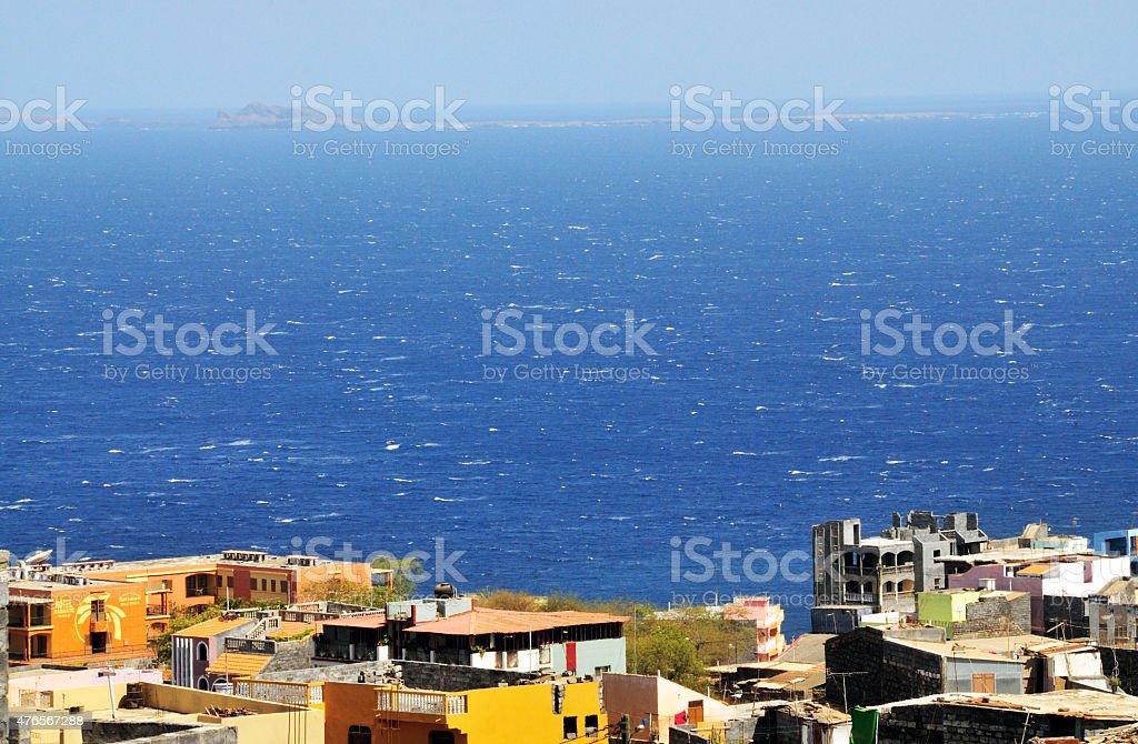 Homes over ocean stock photo