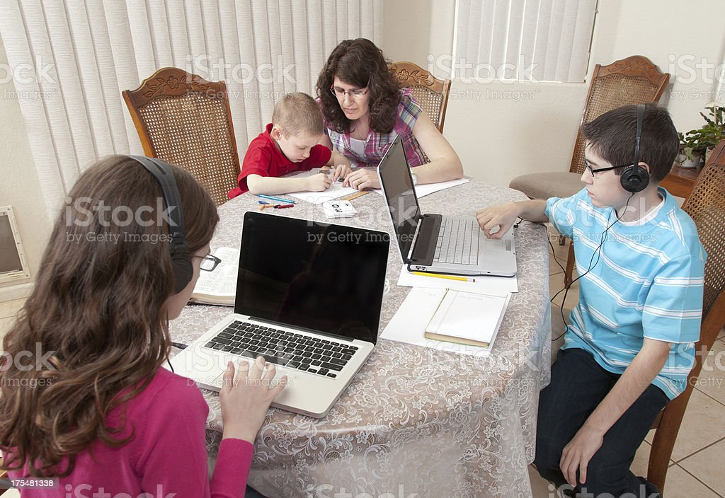 Homeschooling at the Kitchen table royalty-free stock photo