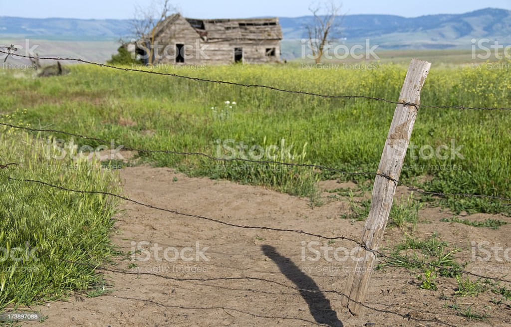 Homesteader's farmhouse and fence royalty-free stock photo