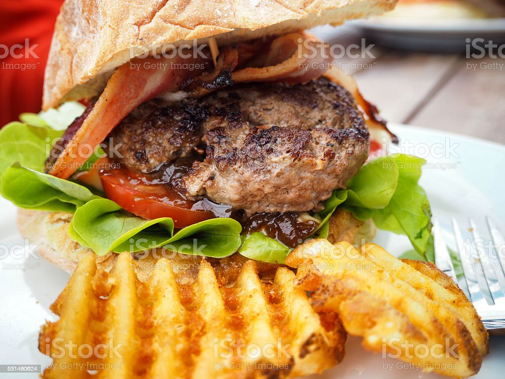 Home-style burger with savory chunky beef patty stock photo