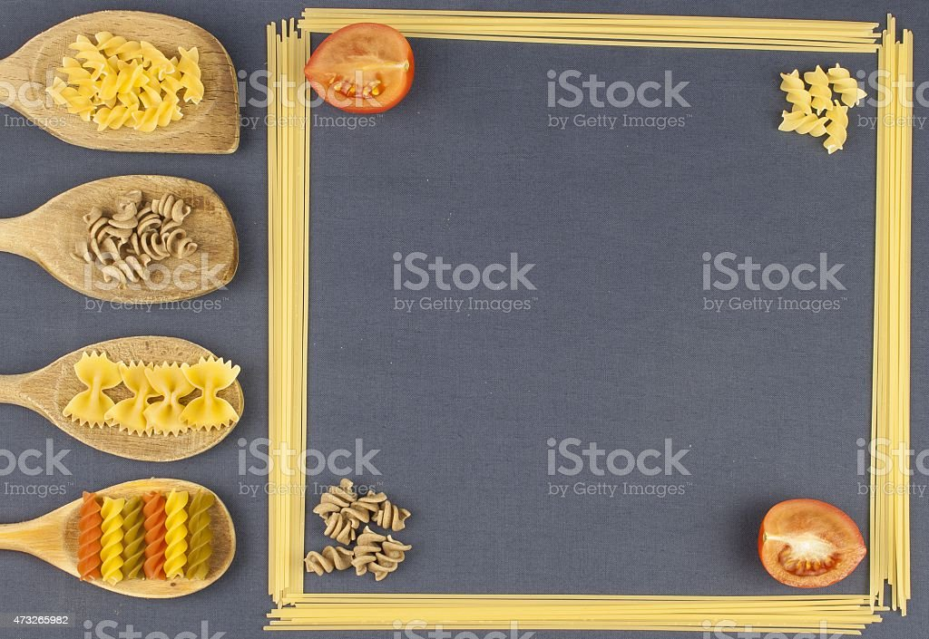 Homework pasta, creating the menu, spoons with pasta and spaghetti stock photo