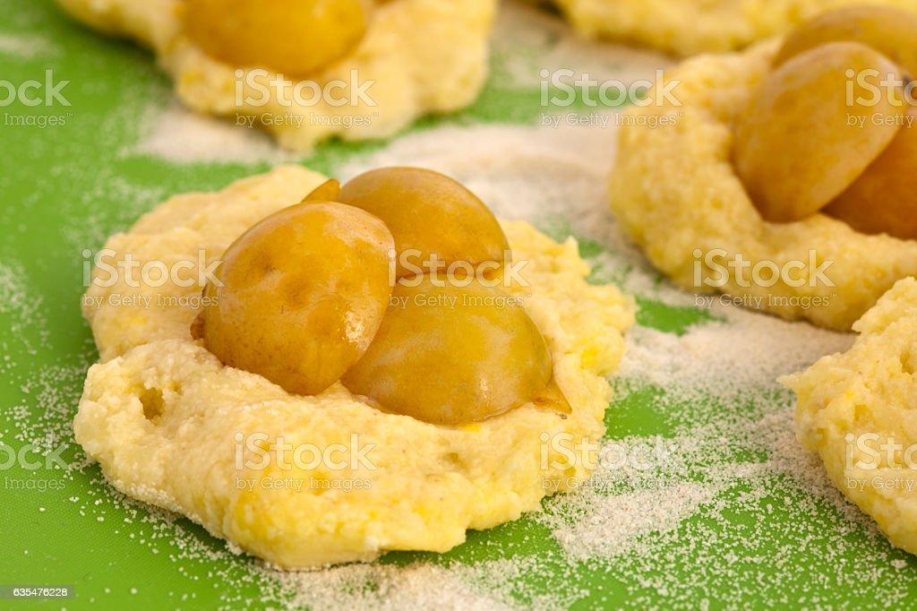 Homework potato dumplings with mirabelle plums stock photo