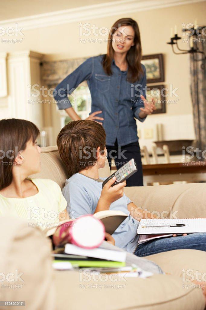 Homework versus TV royalty-free stock photo