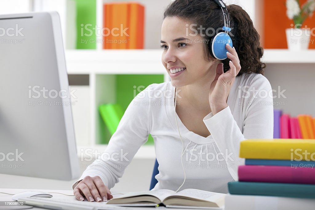 homework with headphones royalty-free stock photo