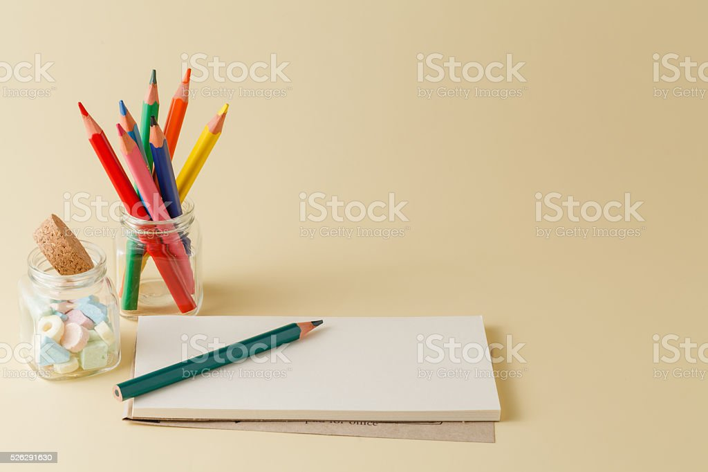 Homework workplace with color pencil an mpti notepad stock photo