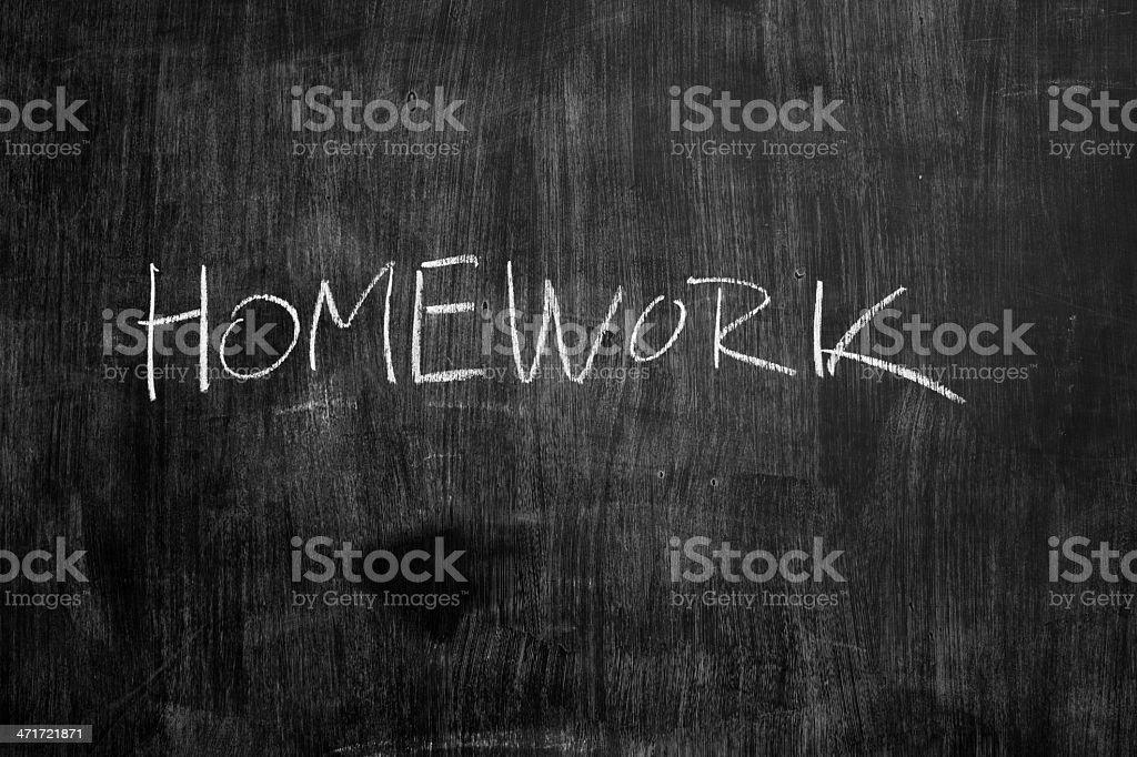 Homework written in chalk on blackboard royalty-free stock photo