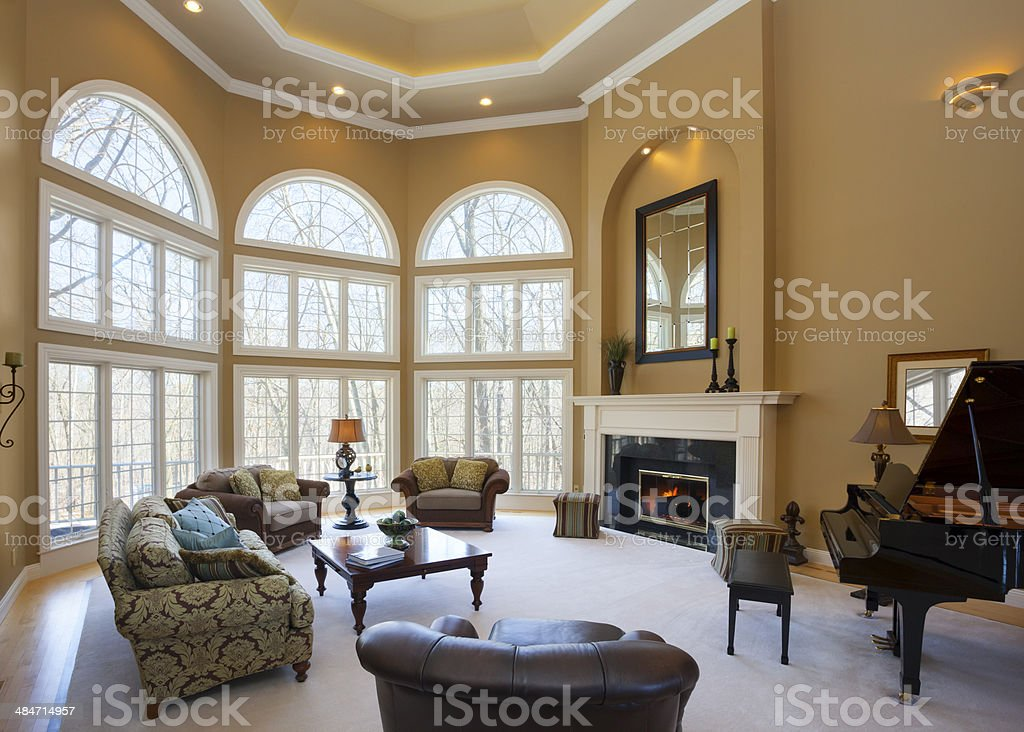 Homey Great Room With Vaulted Ceiling and Grand Piano stock photo