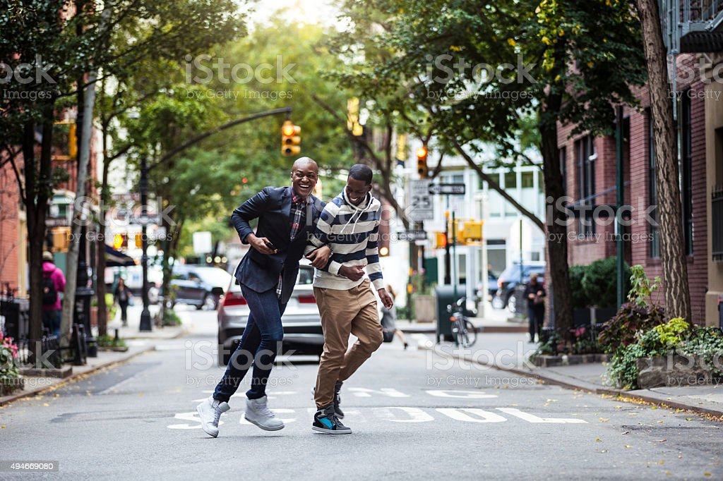 Homosexual couple crossing the street Greenwich Village - NY stock photo