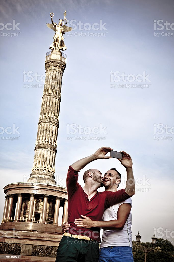 homosexual couple picturing selfie in front of Berlin Victory Column royalty-free stock photo