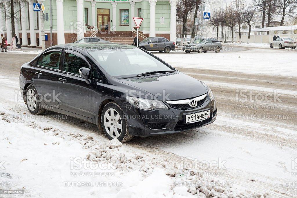 Honda Civic Hybrid parked in winter street. stock photo