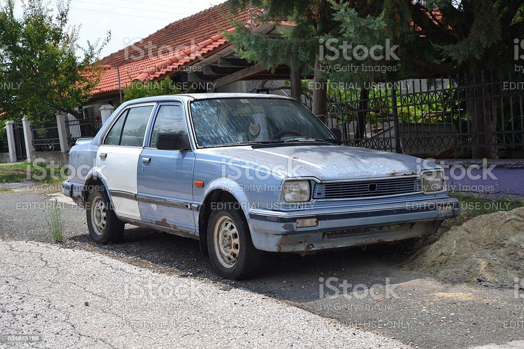 Honda Civic II dying on the street stock photo