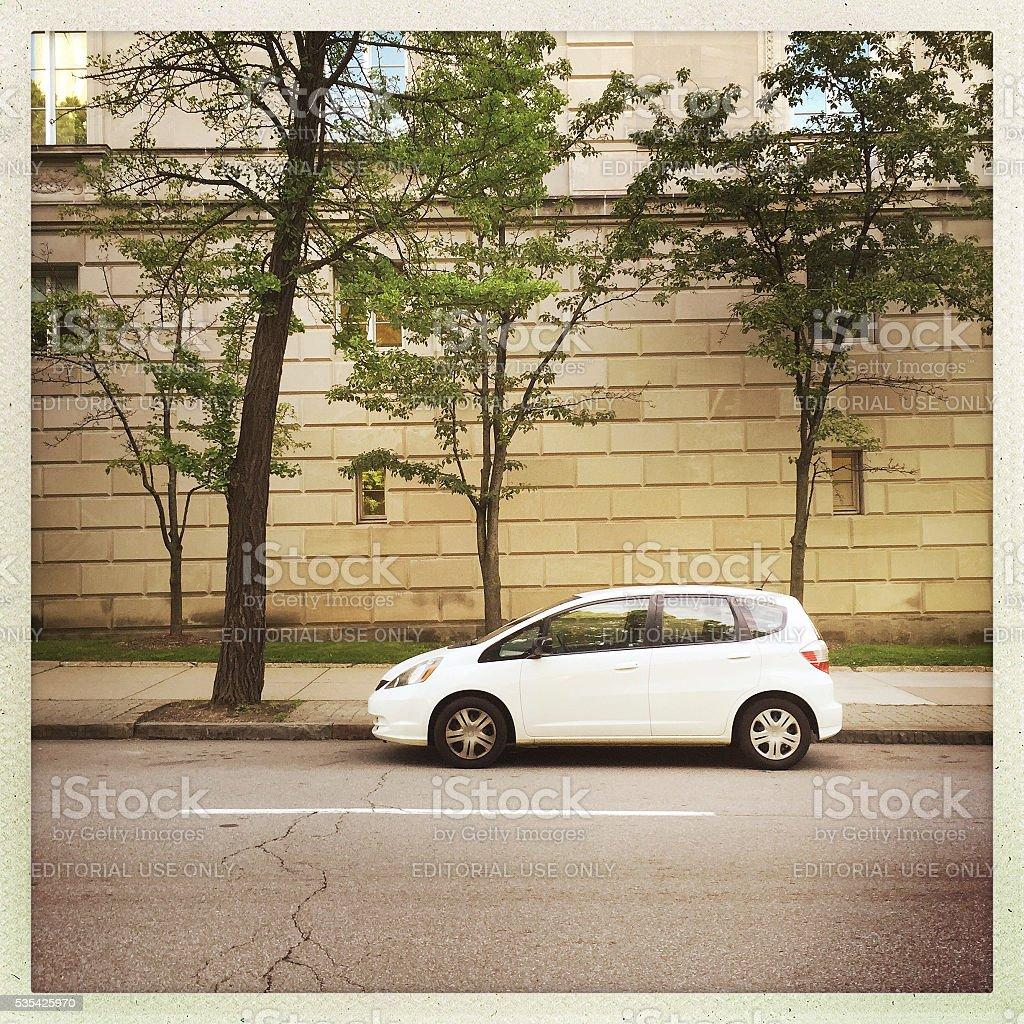 Honda Fit Parked on City Street stock photo
