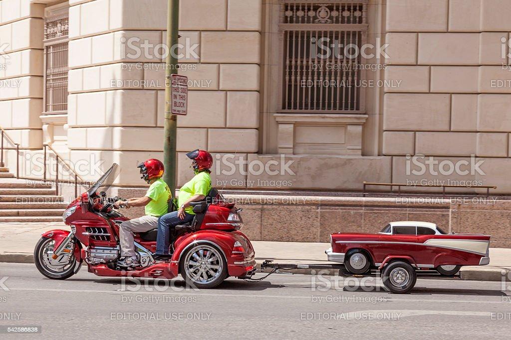 Honda three wheeler with a trailer stock photo
