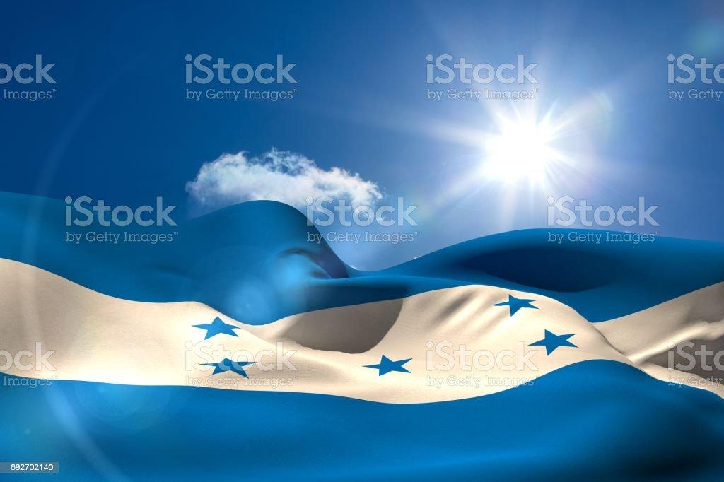 Honduran national flag under sunny sky stock photo